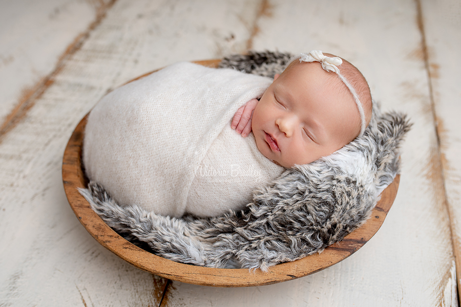 wrapped newborn in wooden bowl photography