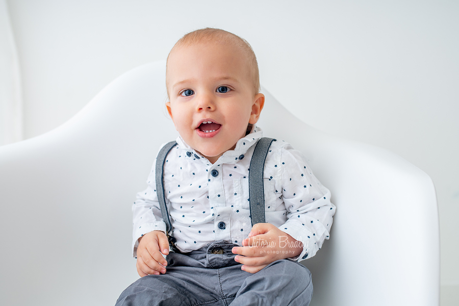 baby on white chair