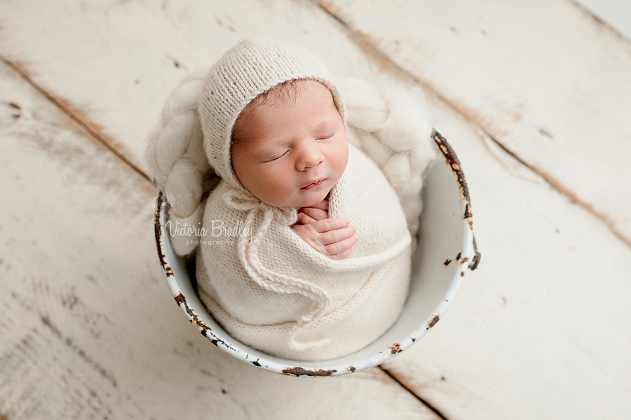 wrapped newborn photography nottingham, cream knitted wrap in white bucket
