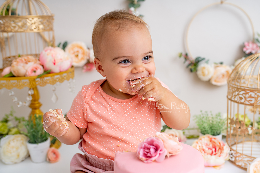 baby girl eating cake