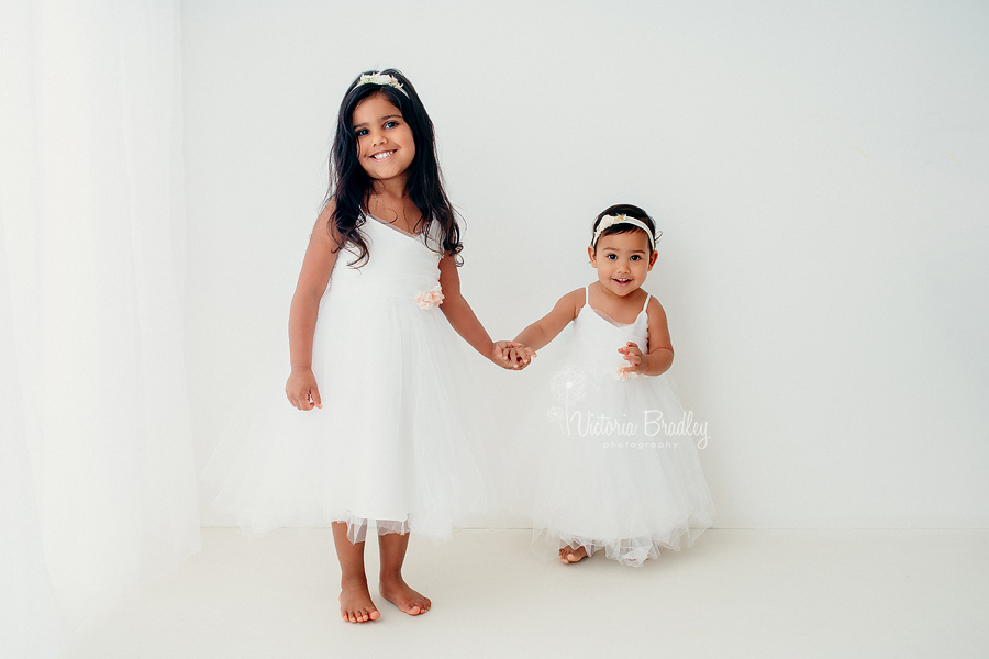 sisters white studio photography