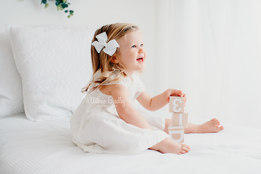 toddler photography white bed set up