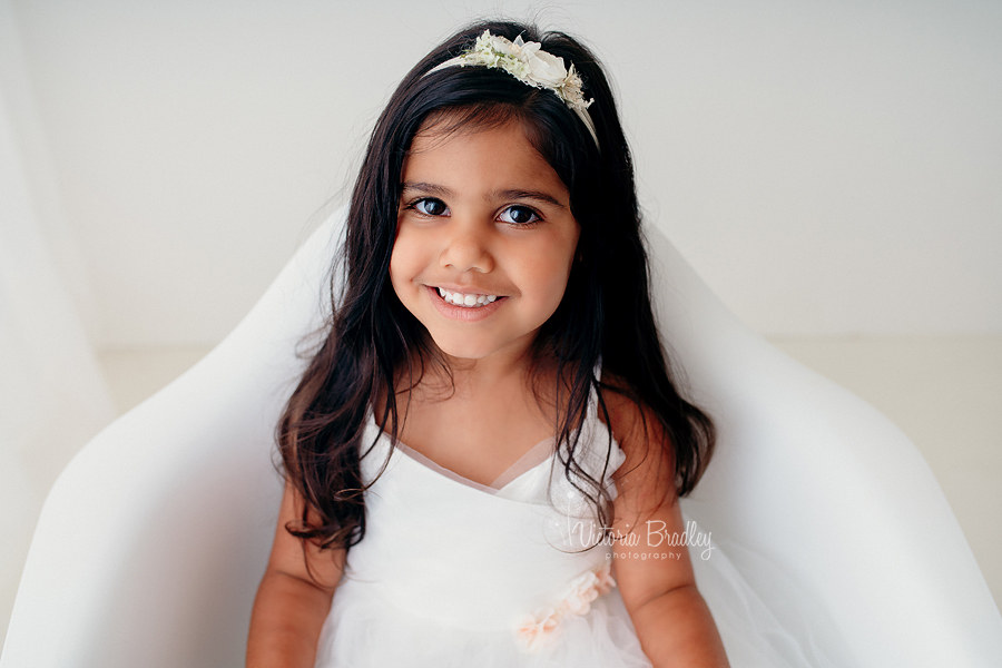 white studio photography 3 year old girl