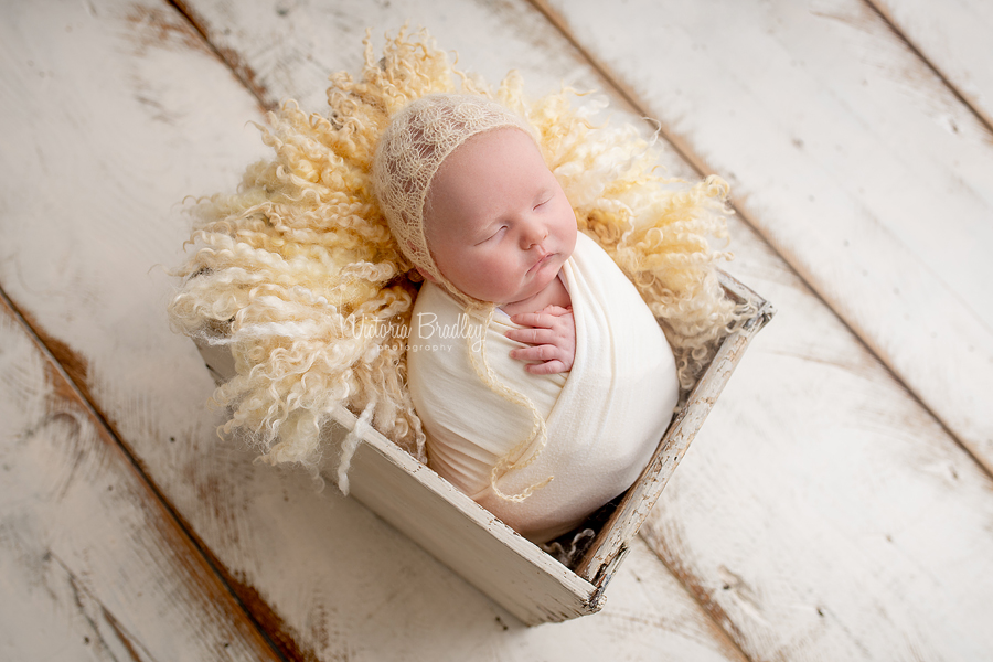 wrapped newborn in pale yellow