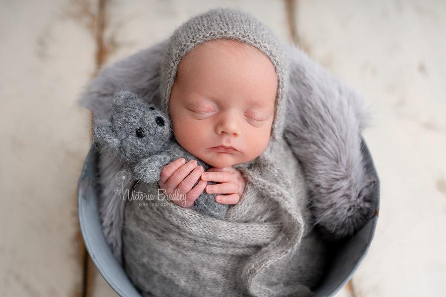 baby boy holding teddy