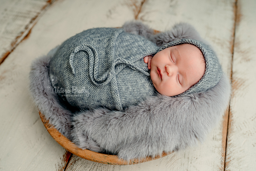 wrapped baby in grey