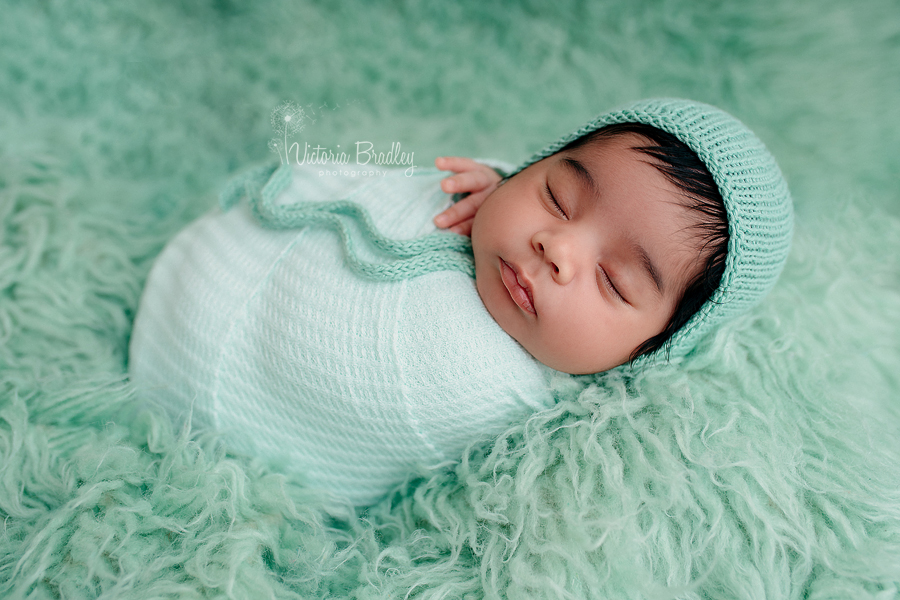 wrapped newborn in mint wrap