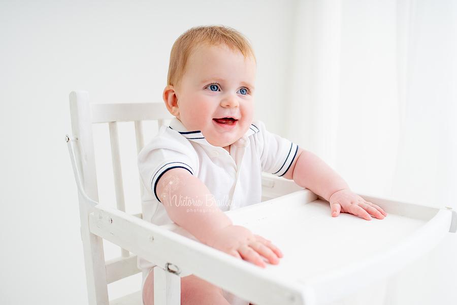sitter baby in white high chair
