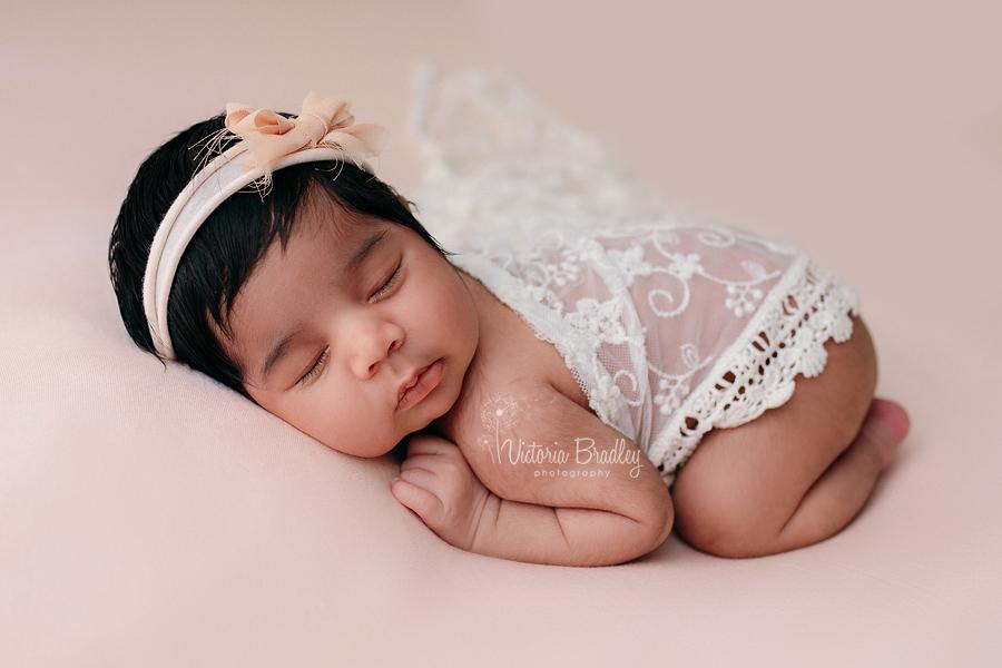 Asleep baby on tummy photography