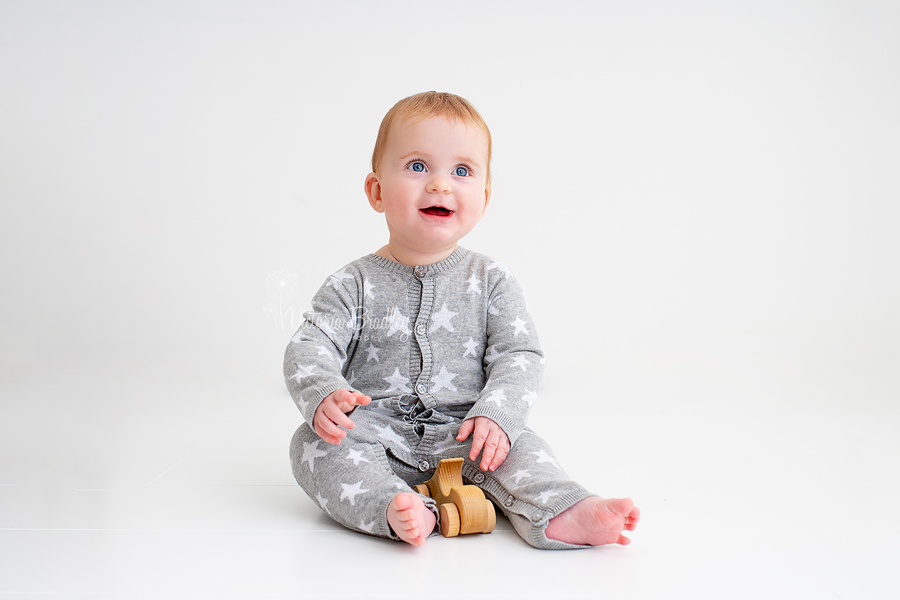 sitter baby boy in grey and white starred romper