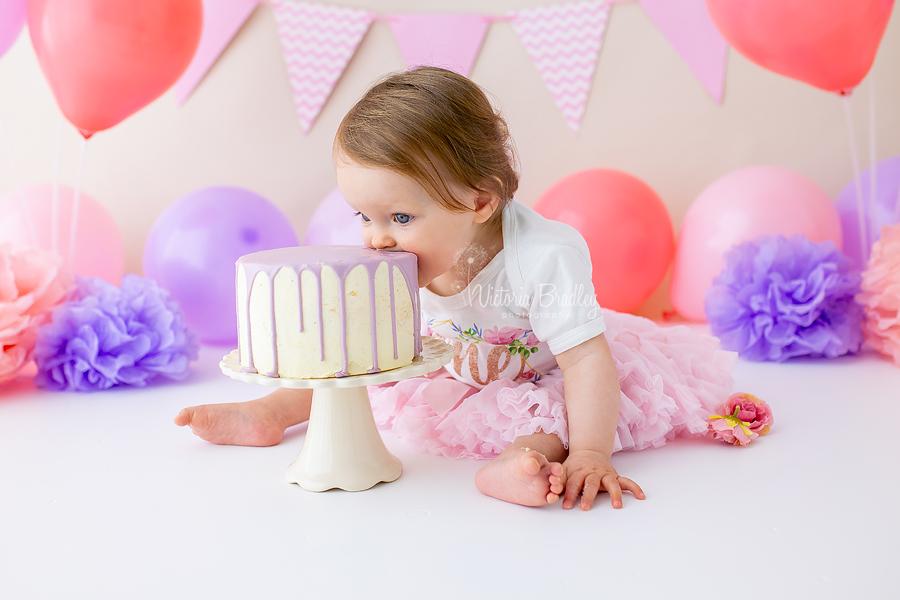 baby girl pink and purple cake smash