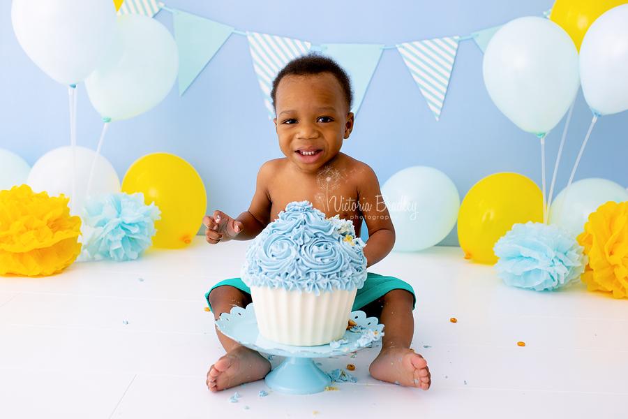 baby boy with giant cupcake cake smash