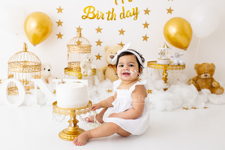 first birthday gold and white cake smash