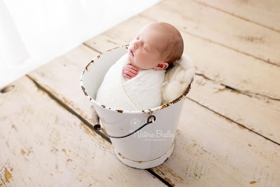 wrapped newborn in bucket