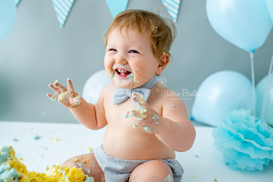 laughing baby cake smash blues and grey
