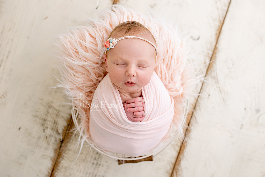 wrapped newborn in peach photography
