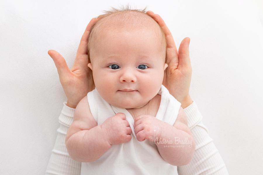 baby boy in mummy's hands
