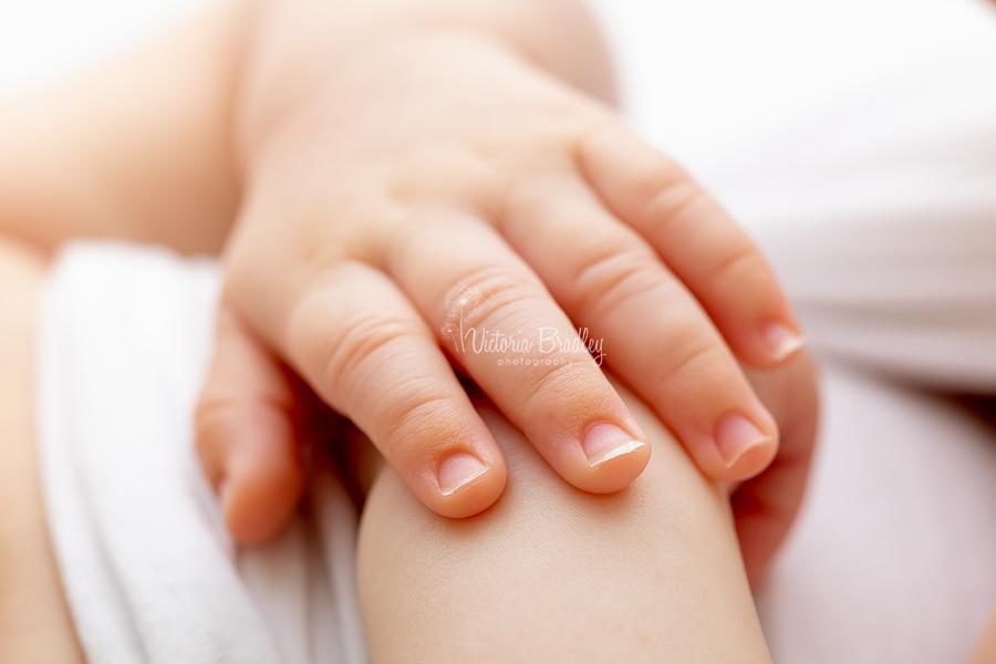 close up macro of newborn fingers