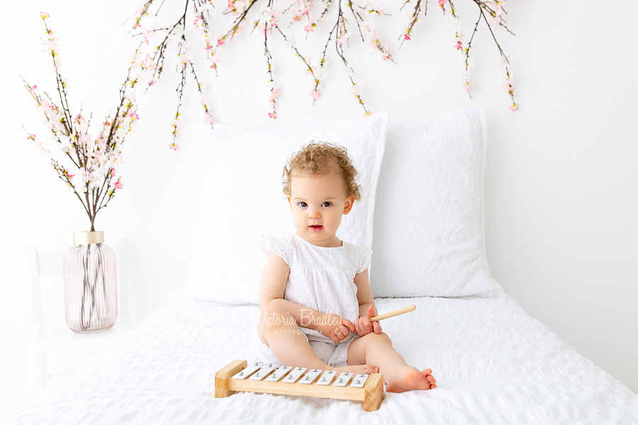 baby on white with blossom