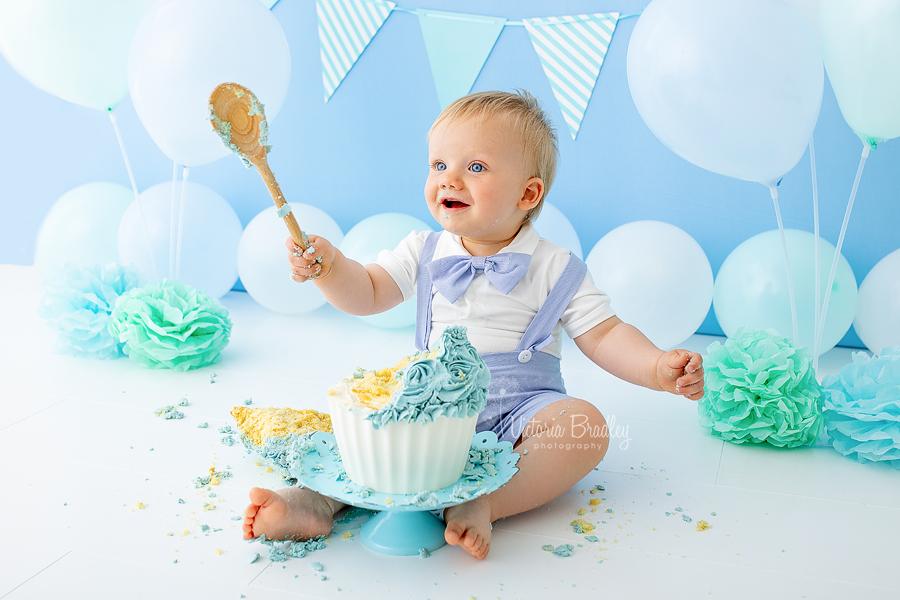 baby boy blue cake smash, practicing for Hogwarts