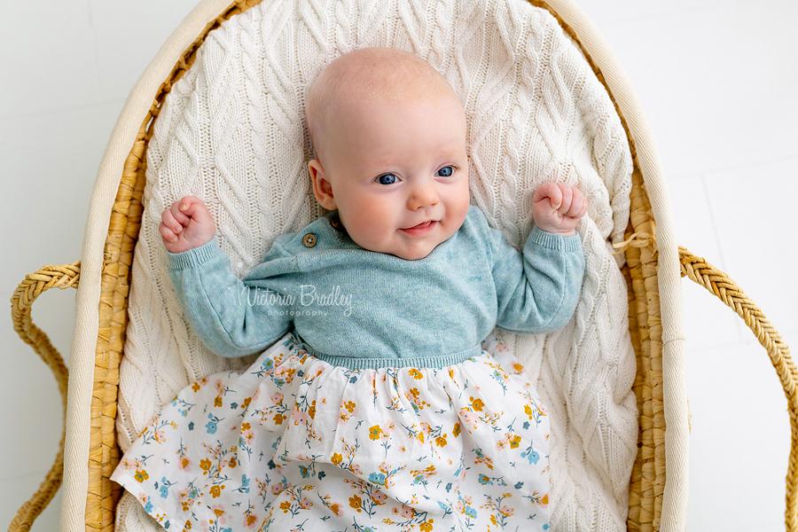 newborn baby in Moses basket