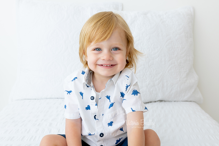 toddler photograph on white bed