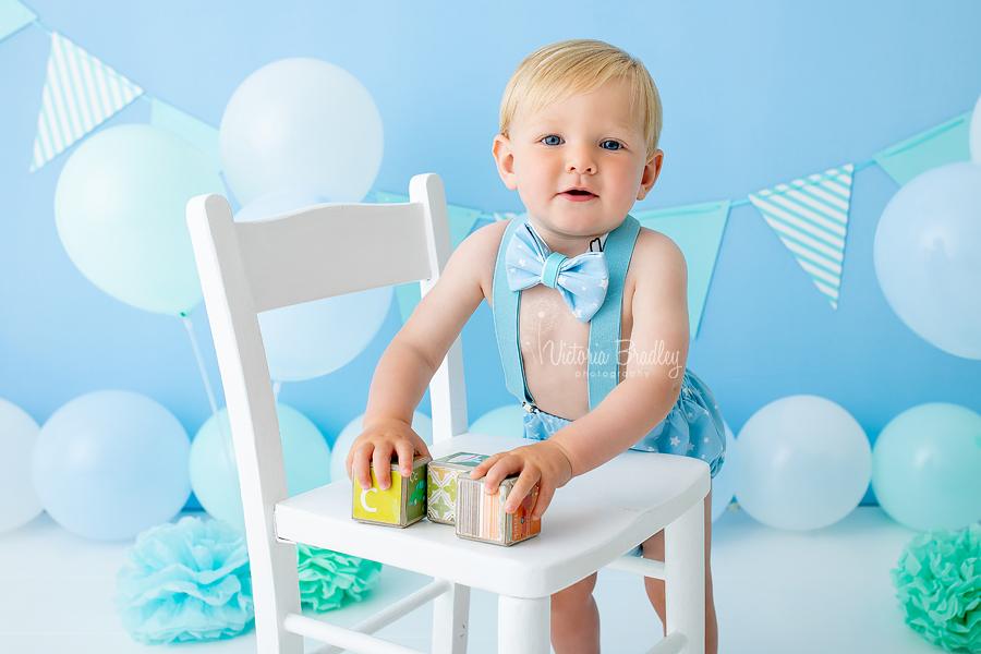 baby boy in blues cake smash