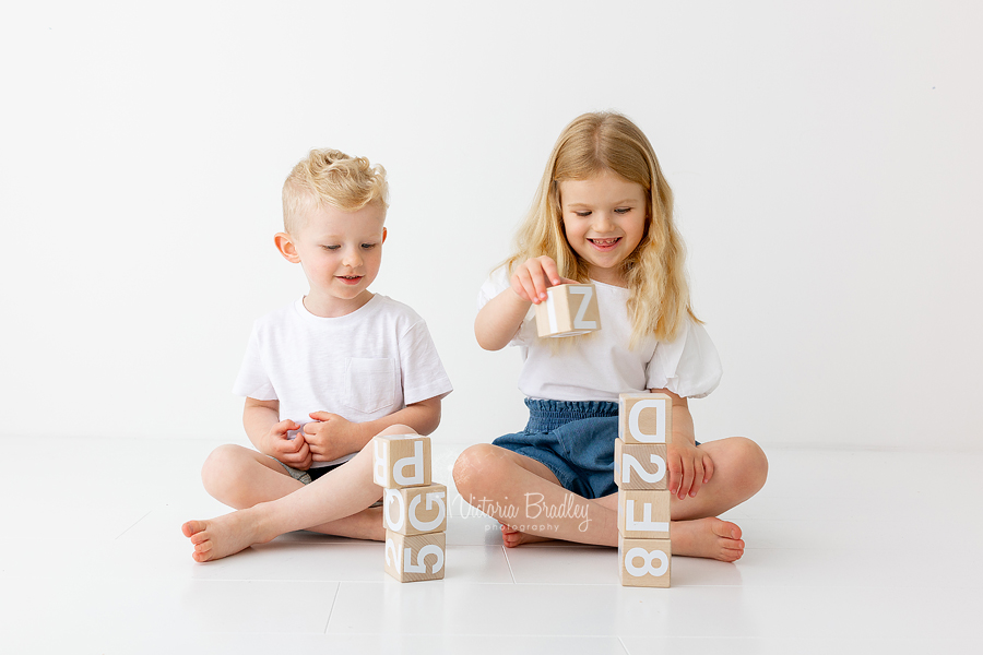 sibling white room photography