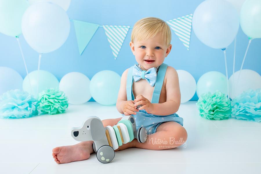 1 year old baby sat on cake smash set