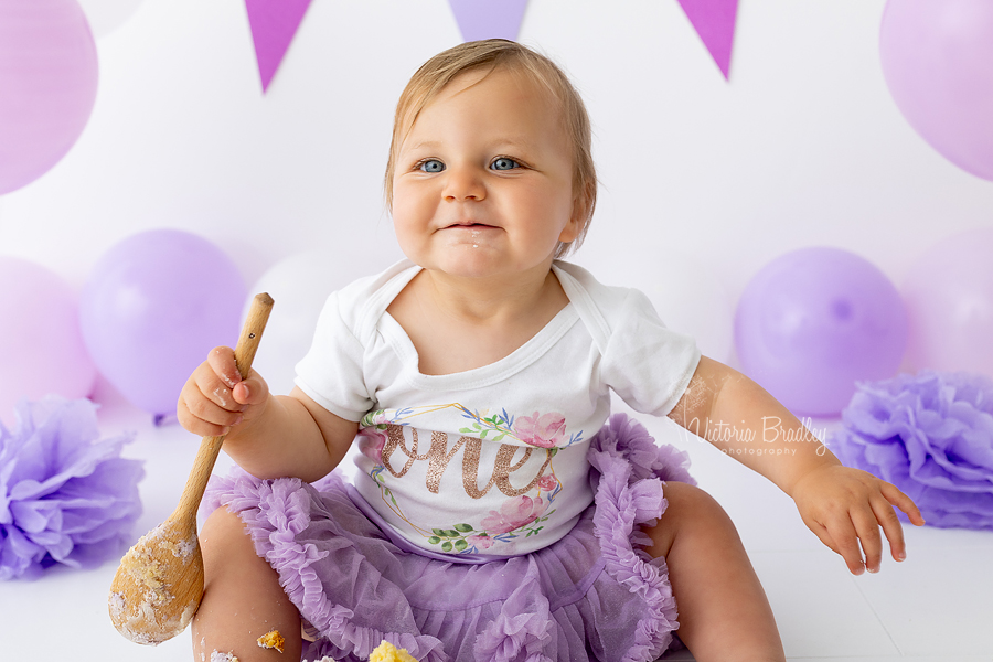 smiling baby cake smash