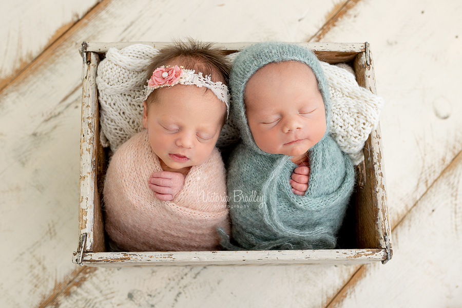 twins wrapped in crate