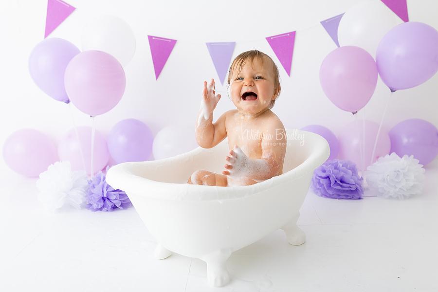 baby in bath tub lilac cake smash