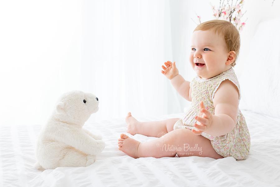 baby with polar bear toy