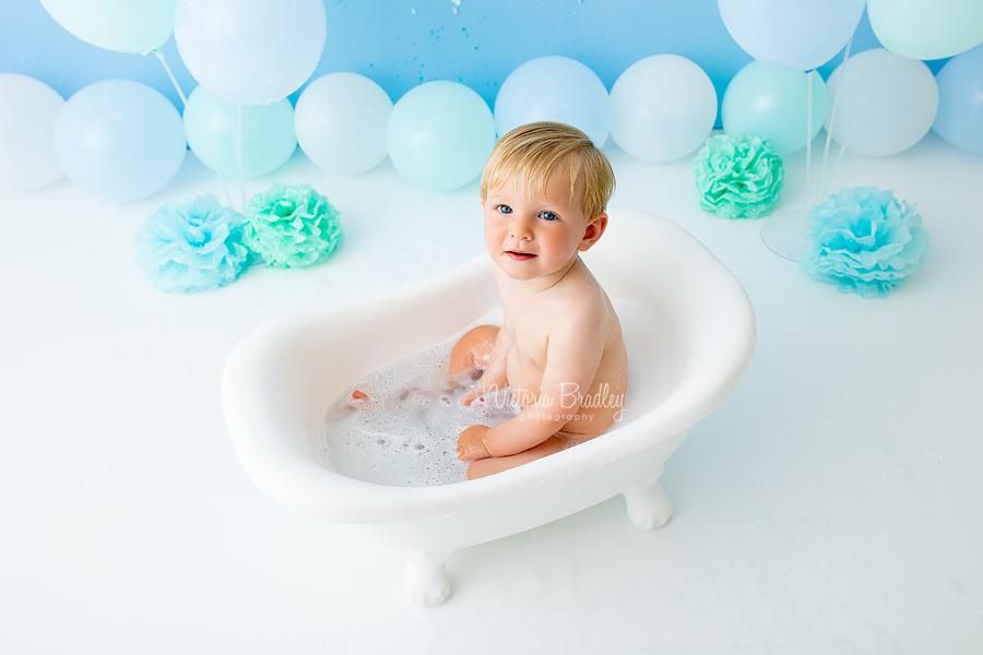 baby boy in bath tub cake smash