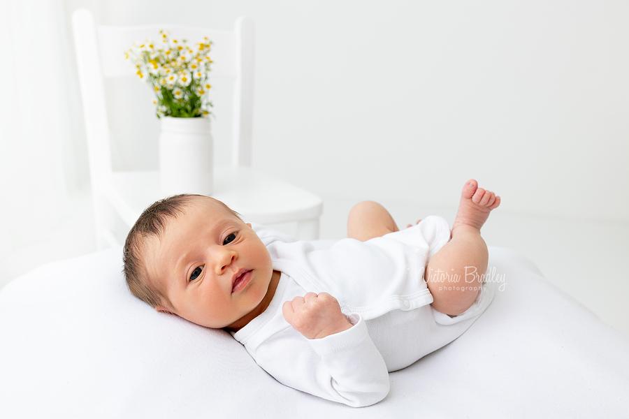 Newborn on white with Daisies