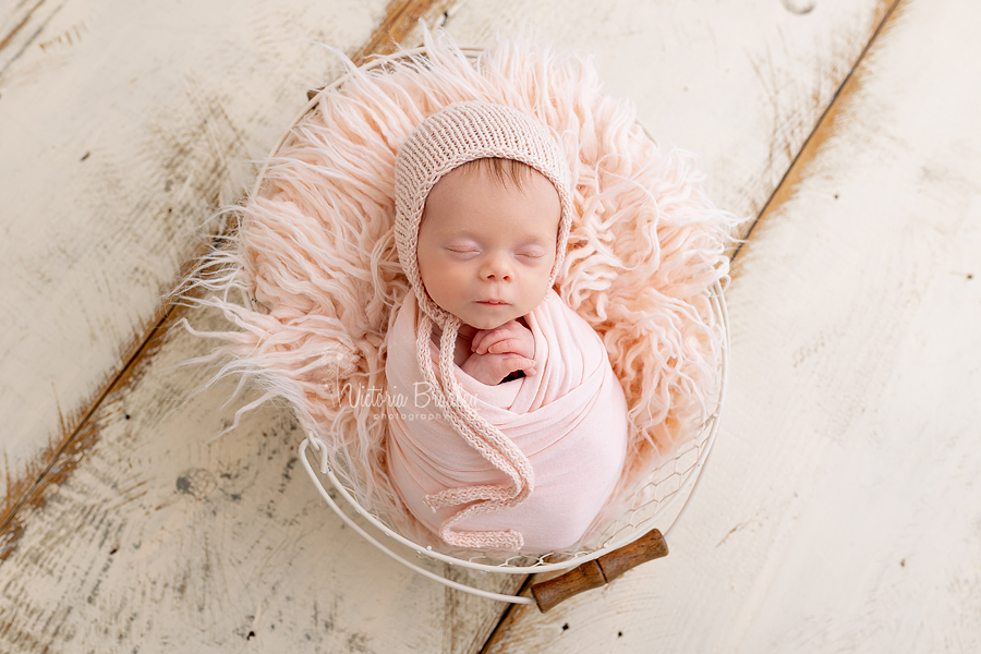 wrapped newborn in pink