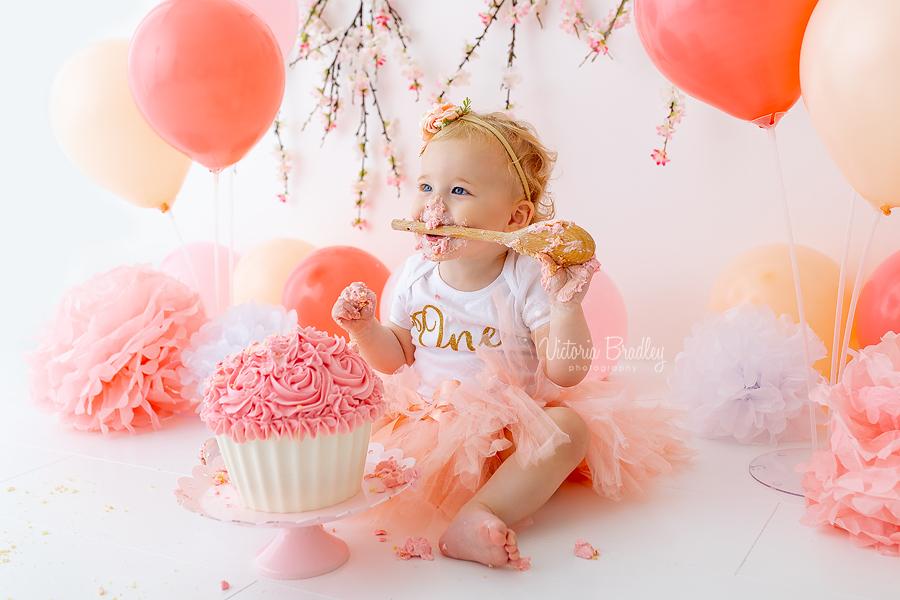 peachy pink girl cake smash