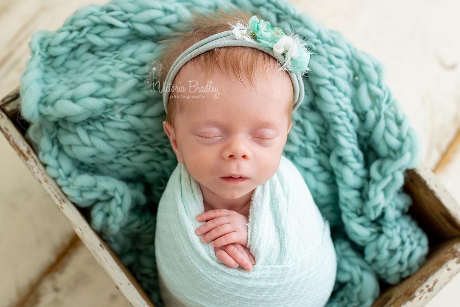 wrapped newborn in mint