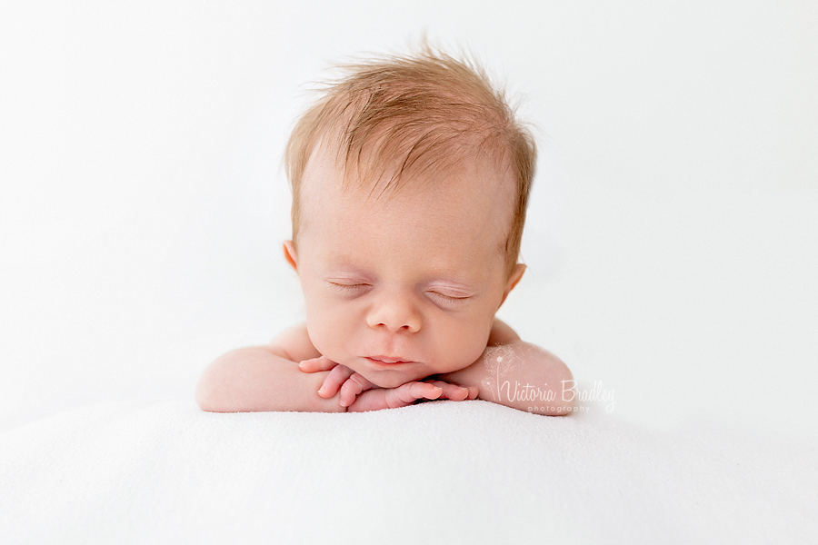 chin on hands newborn pose
