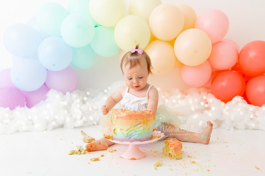 cake smash rainbow balloon arch
