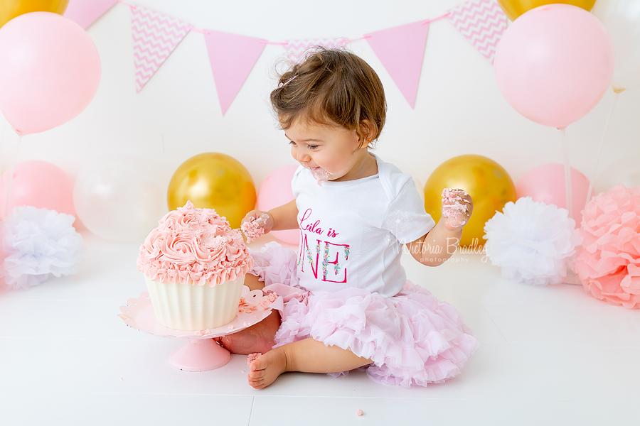 happy baby girl cake smash