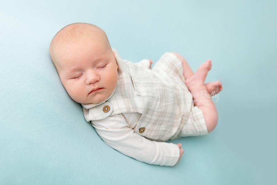 asleep older newborn on blue
