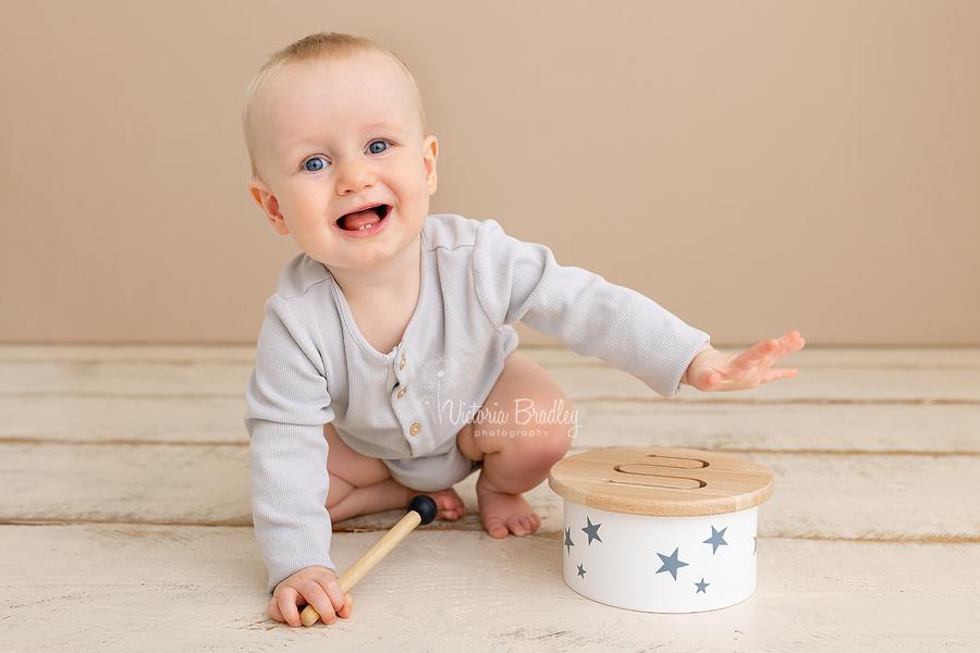 happy baby with drum
