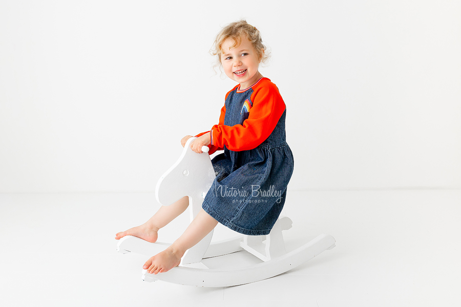 4 year old girl on rocking horse