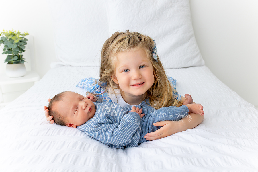 sibling and newborn